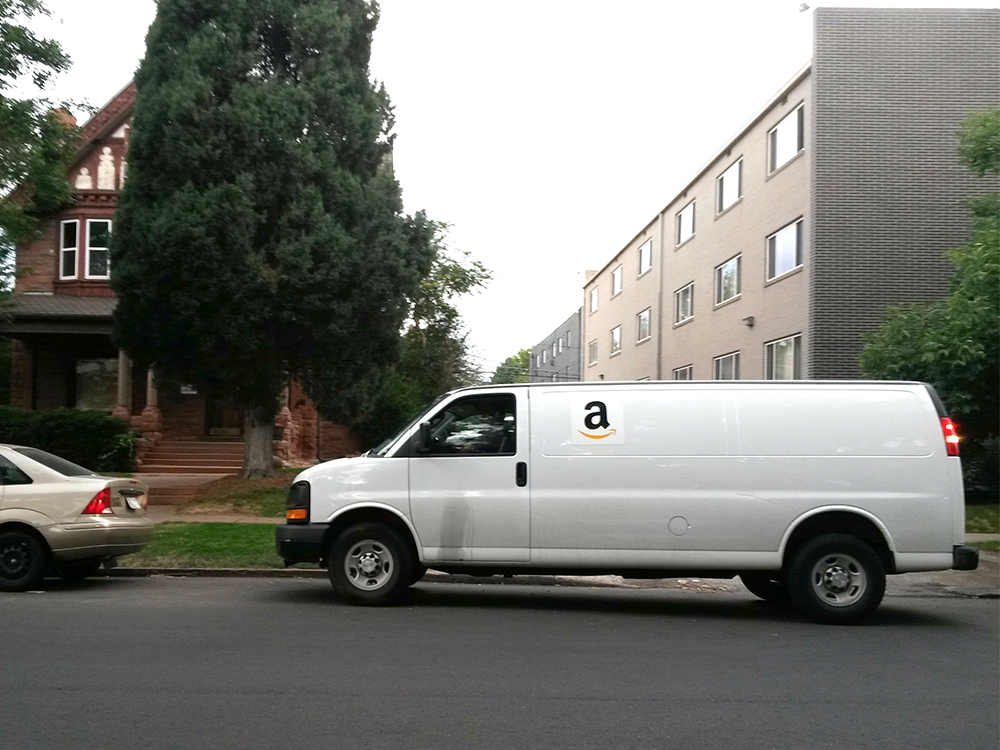 An Amazon Flex van parked in City Park West. (Kevin J. Beaty/Denverite)  amazon flex; delivery; kevinjbeaty; denverite; denver; colorado;