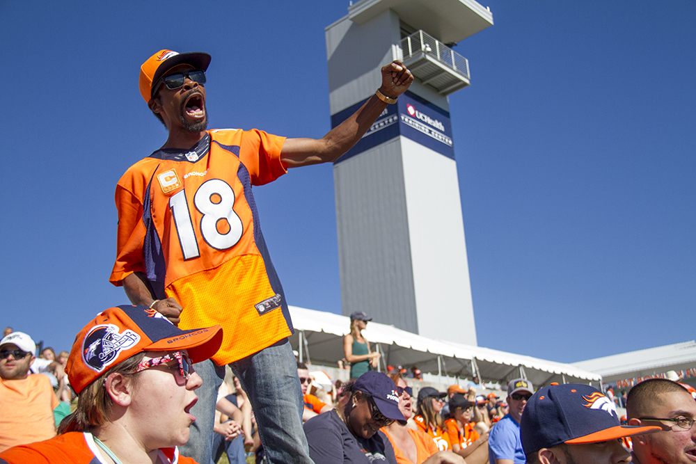 Richard Wader III leads the crowd in chants during Denver Broncos Training Camp. (Kevin J. Beaty/Denverite)  broncos; football; training camp; sports; kevinjbeaty; denver; denverite; colorado;