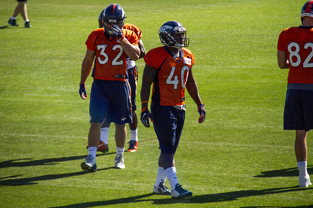#40 Juwan Thompson and #32 Andy	Janovich on the field during Denver Broncos Training Camp. (Kevin J. Beaty/Denverite)  broncos; football; training camp; sports; kevinjbeaty; denver; denverite; colorado;