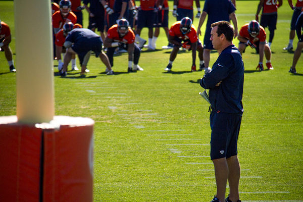 Gary Kubiak watches as his team runs drills at Denver Broncos Training Camp. (Kevin J. Beaty/Denverite)  broncos; football; training camp; sports; kevinjbeaty; denver; denverite; colorado;