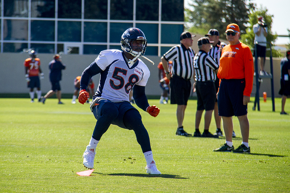 Von Miller runs drills at Denver Broncos Training Camp. (Kevin J. Beaty/Denverite)  broncos; football; training camp; sports; kevinjbeaty; denver; denverite; colorado;