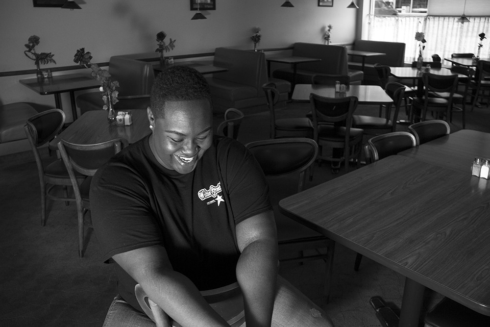 Welton Street Cafe owner Fathima Dickerson poses for a portrait in her family's restaurant. (Kevin J. Beaty/Denverite)  welton street; five points; development; kevinjbeaty; denver; denverite; colorado;