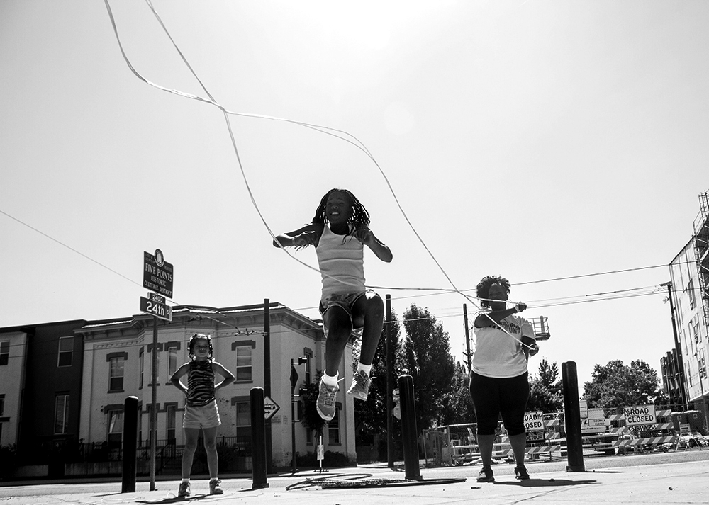 Akhalya Blanton skips rope at Five Points' Sonny Lawson Park with Black Girls Jump, an organization committed to promoting active lifestyles for kids. Her mom Tamara (right) is the president of the Denver chapter. (Kevin J. Beaty/Denverite)  five points; sonny lawson park; kids; jump rope; black girls jump; kevinjbeaty; denver; denverite; colorado;