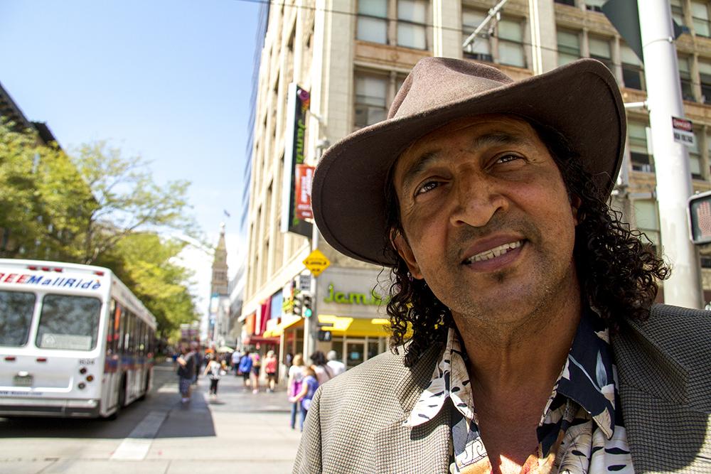 Musician Kasey Davis left Louisiana after Hurricane Katrina and has made Denver home. Spotted on the 16th Street Mall. (Kevin J. Beaty/Denverite)  sixteenth street; 16th street mall; cbd; central business district; downtown; denver; colorado; kevinjbeaty; denverite;