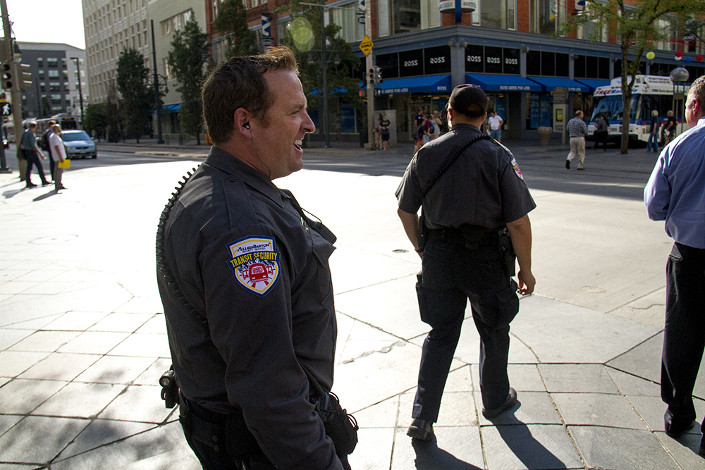 A contract security guard on the 16th Street Mall. (Kevin J. Beaty/Denverite)  16th street mall; sixteenth street; central business district; downtown; denver; colorado; kevinjbeaty; denverite; cbd;