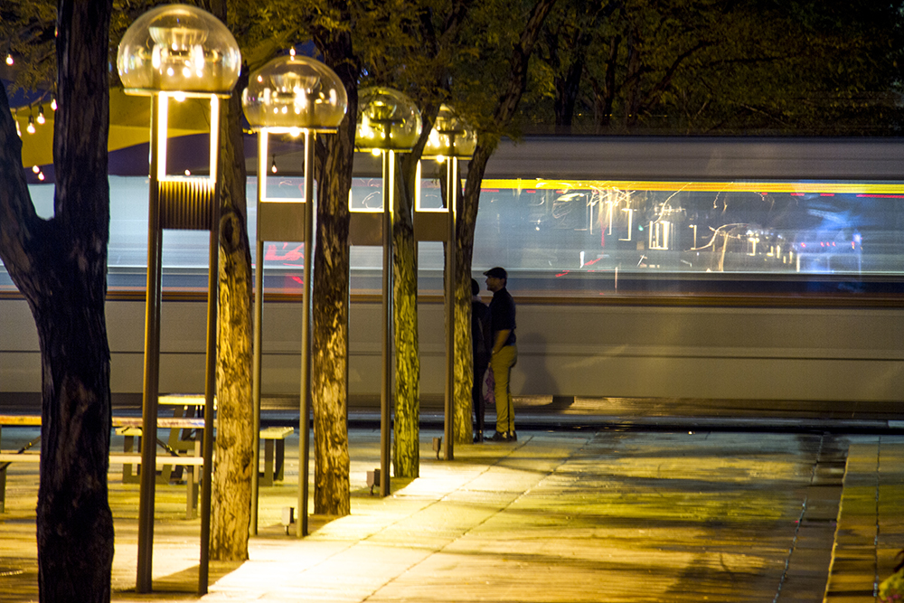 An RTD train speeds past the 16th Street Mall. (Kevin J. Beaty/Denverite)