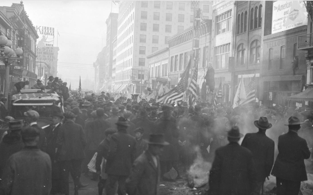 An Armstice Day parade on 16th Street marks the end of World War I in 1918. For some reason, an effigy is hanging. (Denver Public Library/Western History Collection/X-18719)