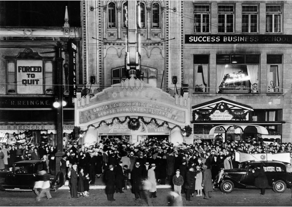 People crowd the 16th Street entrance of the Denver Theater at 510 16th Street in 1934. Note that the car has loudspeakers on its roof. (Denver Public Library/Western History Collection/X-24602)