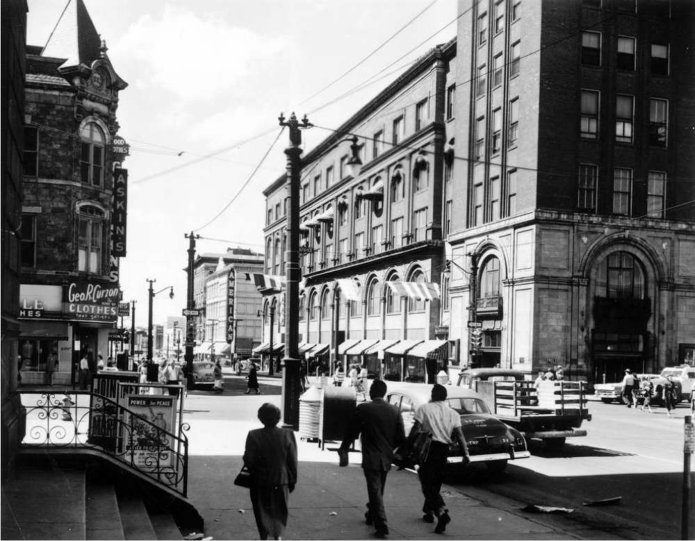 People walk along 16th Street near Arapahoe Street in Denver, near the Daniels & Fisher Building, in 1957. (Denver Public Library/Western History Collection/X-11000120)