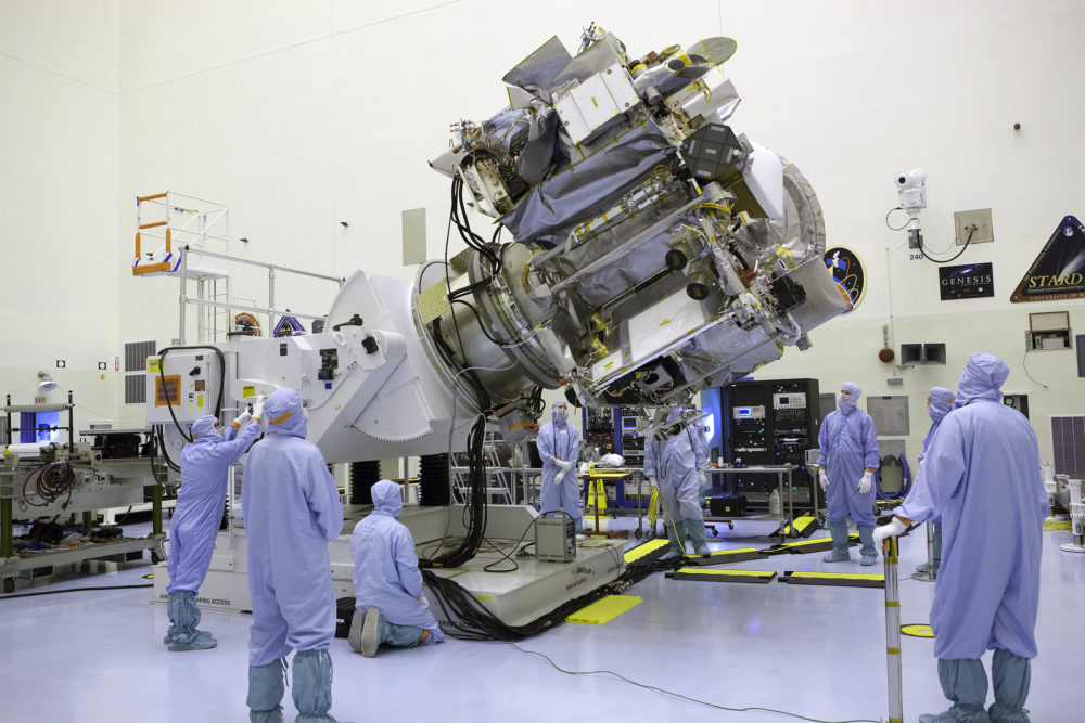Inside the Payload Hazardous Servicing Facility at NASA's Kennedy Space Center in Florida, technicians and engineers rotate the OSIRIS-REx spacecraft for testing. (NASA/Dimitri Gerondidakis)
