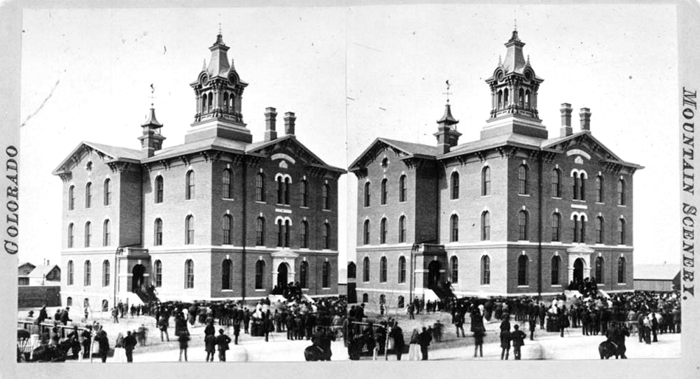 View of the Arapahoe School in Denver, Colorado; people crowd the yard and entry steps. (Denver Public Library/Western History Collection/X-28315)  arapahoe high school; historic; denver public library; dpl; archive; archival; denverite
