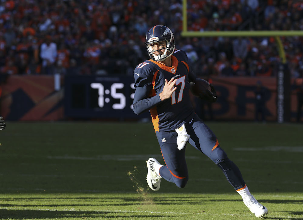 Denver Broncos quarterback Brock Osweiler (17) runs for a 5 yard gain on fourth and one during second quarter action against the Oakland Raiders in the NFL game at Sports Authority Field in Denver, CO, December 13, 2015. (Photo credit: Ben Hays/Denver Broncos)