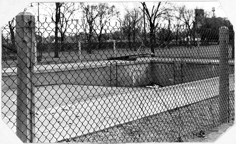 View of a drained swimming pool in Elyria Park at 48th (Forty-eighth) Avenue and High Street in Denver, Colorado. Between 1930 and 1940. (Denver Public Library/Western History Collection/X-20398)  summer; pool; historic; denver public library; dpl; archive; archival; denverite