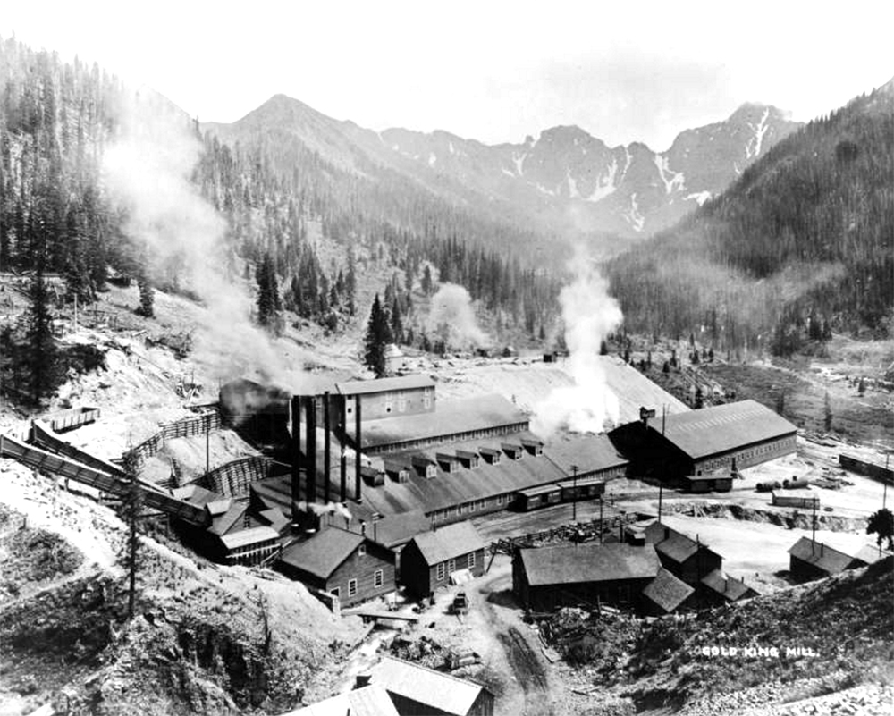 View of the Gold King Mill, in San Juan County Colorado; shows gold mine processing facilities, ore cars, cribbing, smokestacks, tailings, and mountain peaks. Taken between 1880 and 1920. (Denver Public Library/Western History Collection/X-61017)  gold king mine; environment; environmental; silverton; archival; dpl; denver public library; historic; history; denverite; colorado