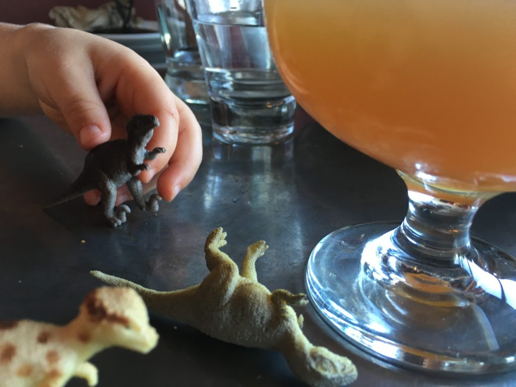 Playing with toy dinosaurs at Trinity Brewing in Colorado Springs. (Dave Burdick/Denverite)