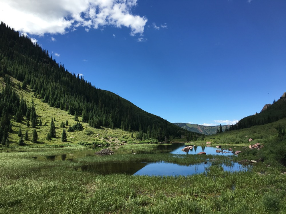 A trailside lake near Snowmass Mountain. (Andrew Kenney/Denverite)