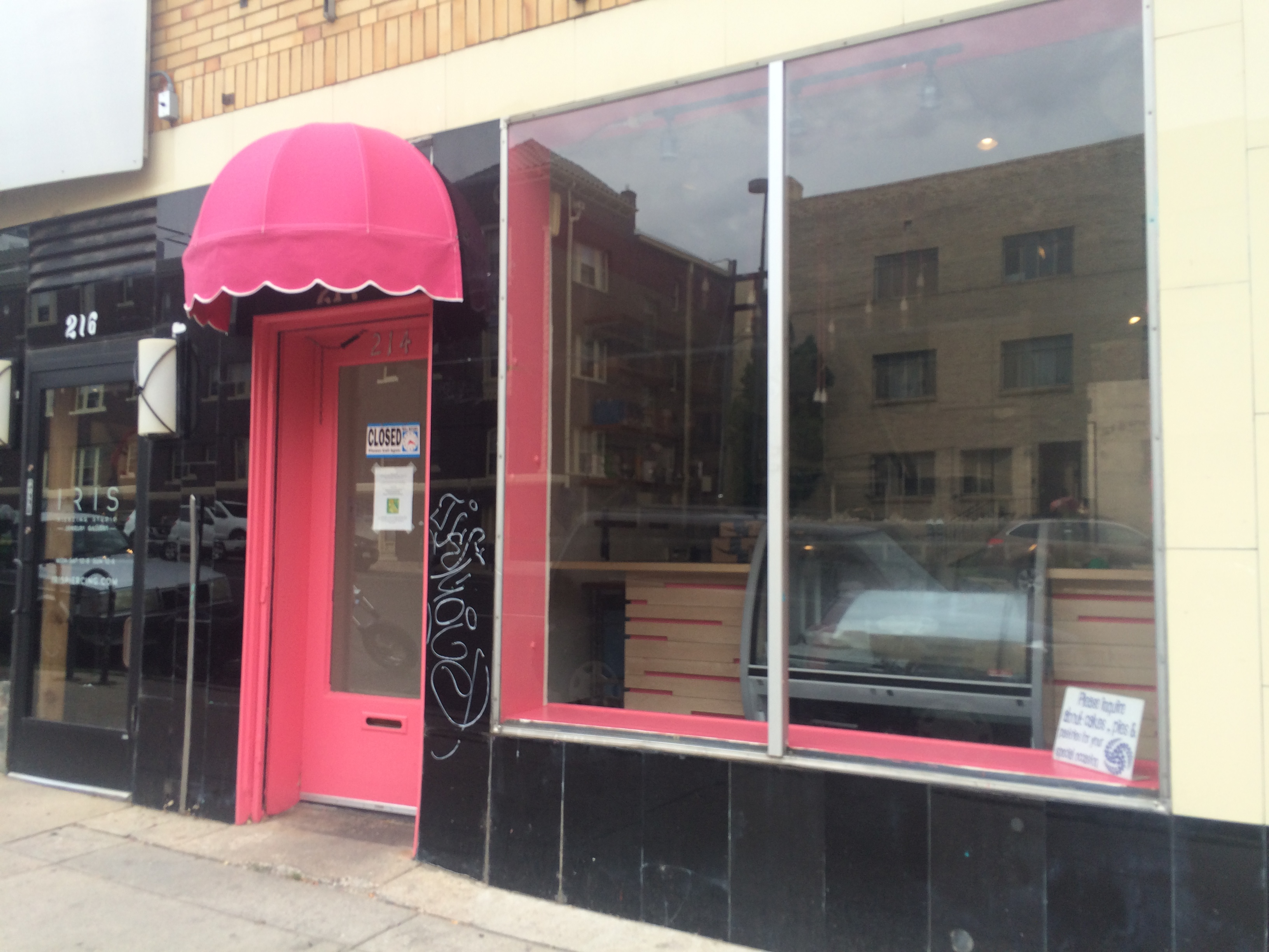 This pink door is where you'll be able to get the vegan treats. (Ashley Dean/Denverite)