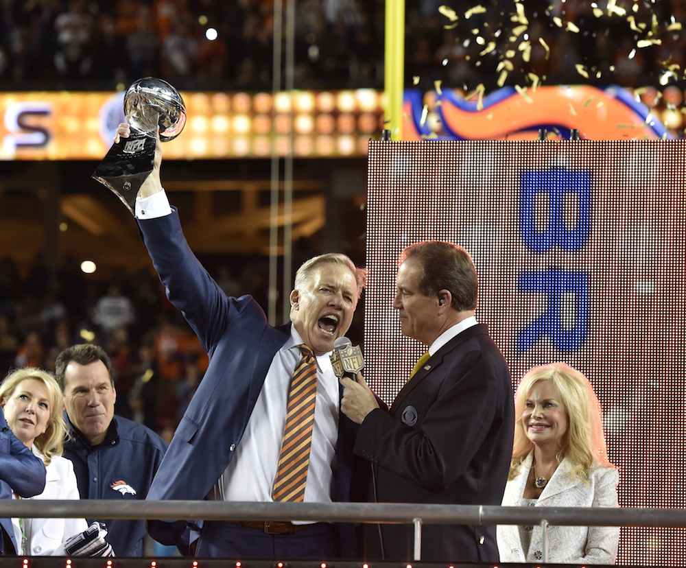 """Executive Vice President of Football Operations/ General Manager John Elway announces the Lombardi Trophy is """"for Pat"""" after defeated  the Carolina Panthers in Super Bowl 50 at Santa Clara, Calif.  February 7, 2016 (Photo by Eric Lars Bakke/ Denver Broncos)"""