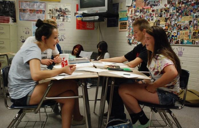 Wheat Ridge High School students discuss a history lesson. (Nicholas Garcia/Chalkbeat)