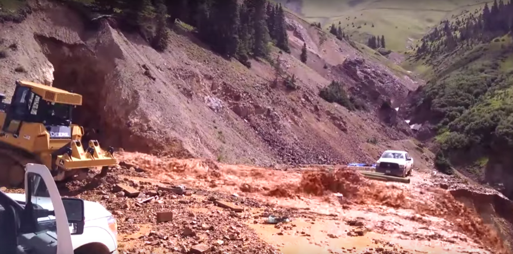 Metal-laced water floods from the Gold King Mine. (EPA/YouTube)