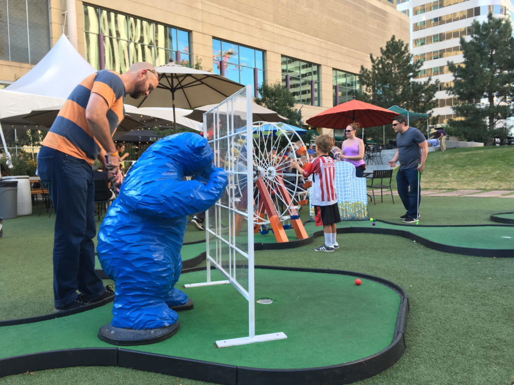 "A miniature ""I See What You Mean"" big blue bear sculpture as a mini-golf obstacle in the beer garden at Skyline Park in downtown Denver. (Dave Burdick/Denverite)"