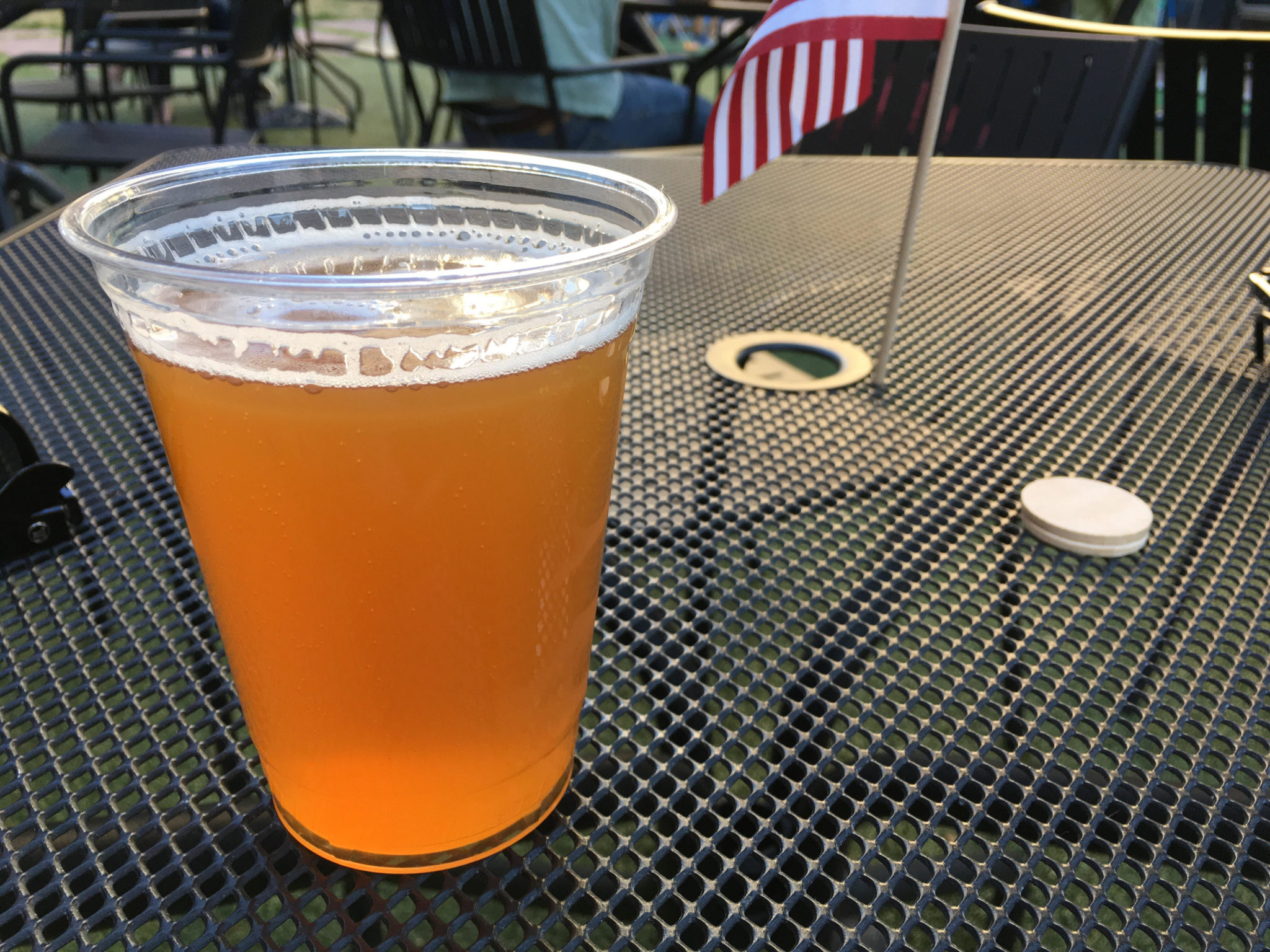An Odell Drumroll American Pale Ale beer at the beer garden at Skyline Park in downtown Denver. (Dave Burdick/Denverite)