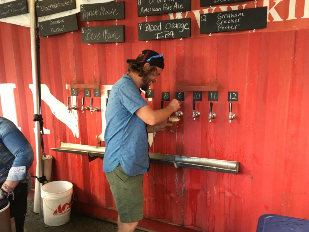 A bartender pours a Tommyknocker blood orange IPA at the Skyline Park beer garden in downtown Denver. (Dave Burdick/Denverite)