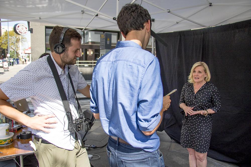 Tamara Door, President of the Partnership, talks at 16th Street Mall Day. (Chloe Aiello/Denverite)