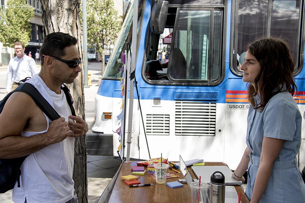 A passerby stops to talk to Denverite's Stephanie Snyder. (Kevin J. Beaty/Denverite)