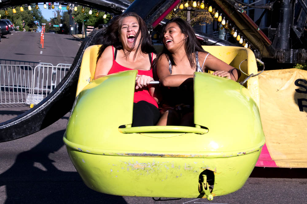 Two women enjoying a ride. (Chloe Aiello/Denverite)