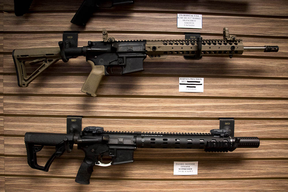 A FN Herstal with silencer and a Barnes Precision rifle. Neither are equipped with bump stocks. (Chloe Aiello/Denverite)