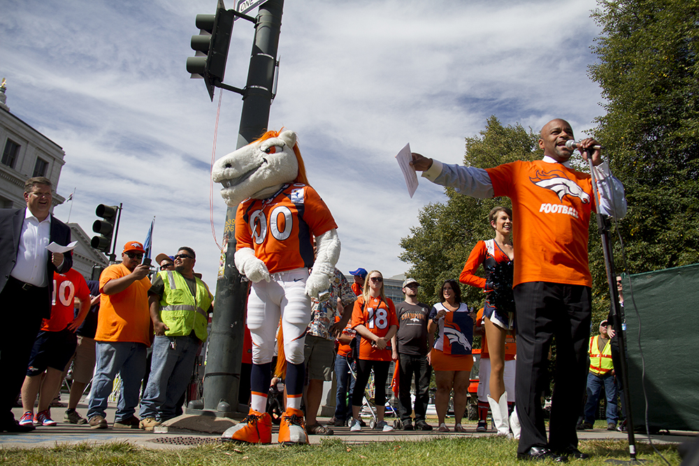 Mayor Hancock speaks at the unvieling of Broncos Boulevard in front of the City and County Building. Sept. 7, 2016. (Kevin J. Beaty/Denverite)  denver broncos; football; civic center park; city and county building; kevinjbeaty; denver; denverite; colorado;