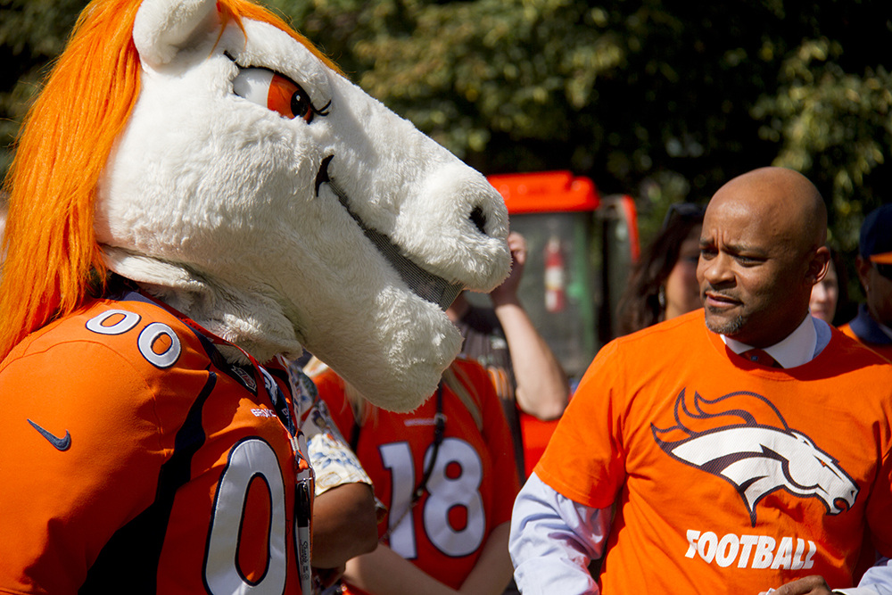 Miles the mascot and Mayor Hancock at the unvieling of Broncos Boulevard in front of the City and County Building. Sept. 7, 2016. (Kevin J. Beaty/Denverite)  denver broncos; football; civic center park; city and county building; kevinjbeaty; denver; denverite; colorado;