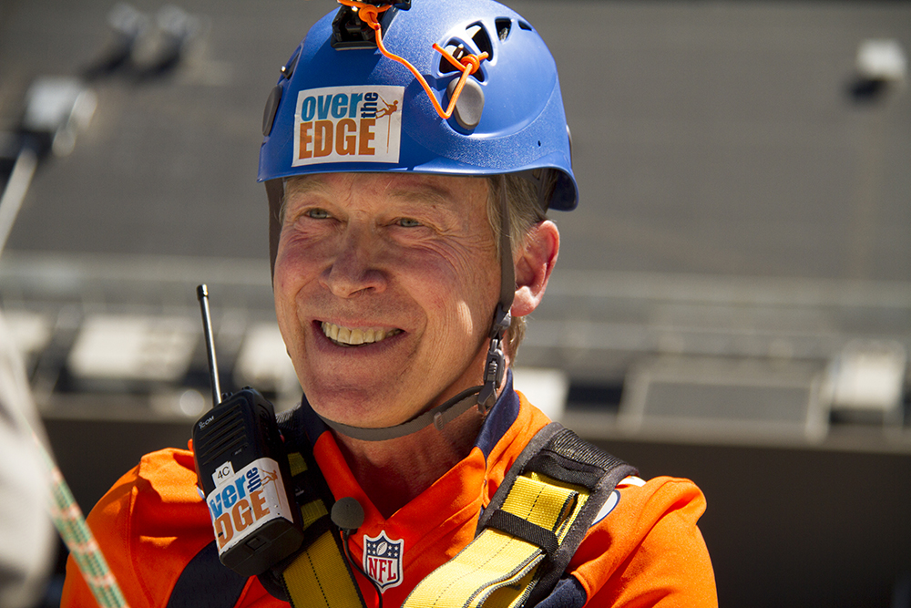 Governor John Hickenlooper rappels off of a skyscraper in downtown Denver. (Kevin J. Beaty/Denverite)  john hickenlooper; rappeling; over the edge; copolitics; kevinjbeaty; denverite; denver; colorado;