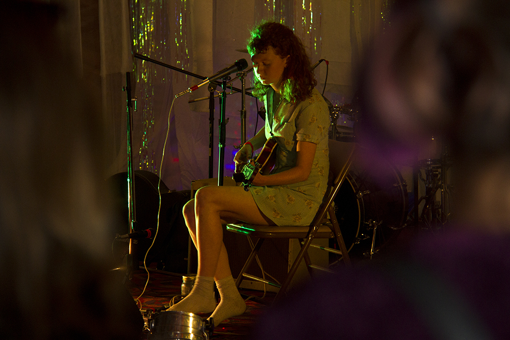 Experimental musician Cecilia McKinnon, AKA Star Canyon, on the guitar. (Kevin J. Beaty/Denverite)