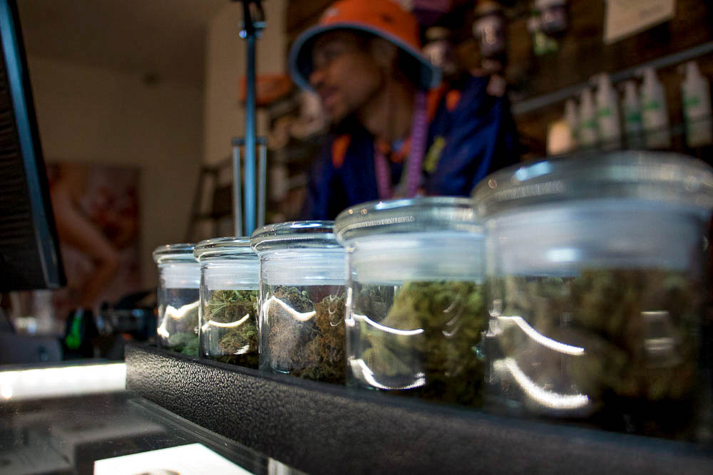 Simply Pure dispensary with Maat Khan behind the counter. (Chloe Aiello/Denverite)