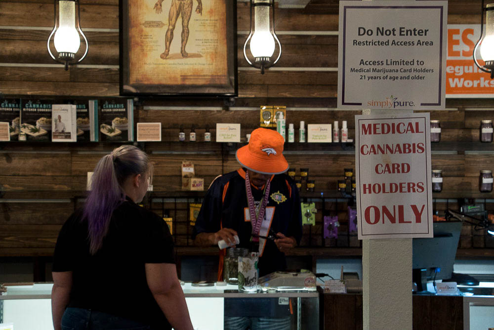Maat Khan and Kristen Amescua at Simply Pure dispensary. (Chloe Aiello/Denverite)