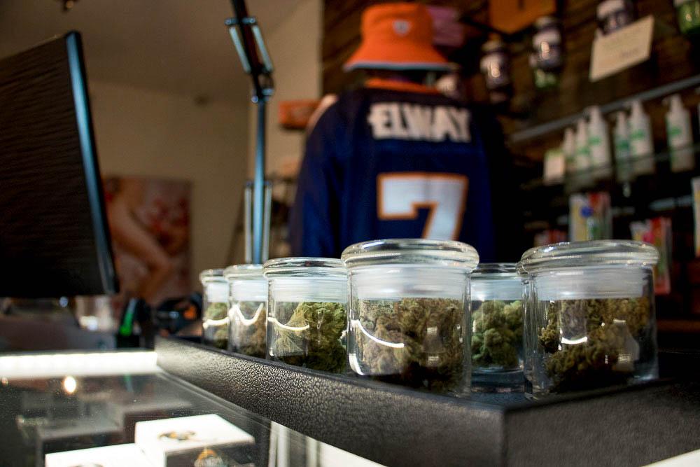 Maat Kahn behind the counter at Simply Pure. (Chloe Aiello/Denverite)