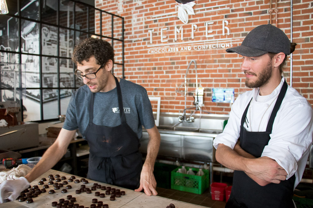 Jon Robbins and Paxton Gross with Temper Chocolates at Central Market. (Chloe Aiello/Denverite)