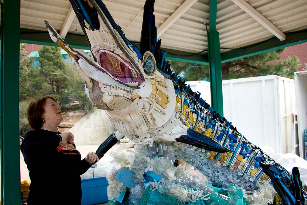Angela Haseltine Pozzi, the artist and Executive Director of Washed Ashore, discusses the garbage used to make Flash the Marlin. (Chloe Aiello/Denverite)