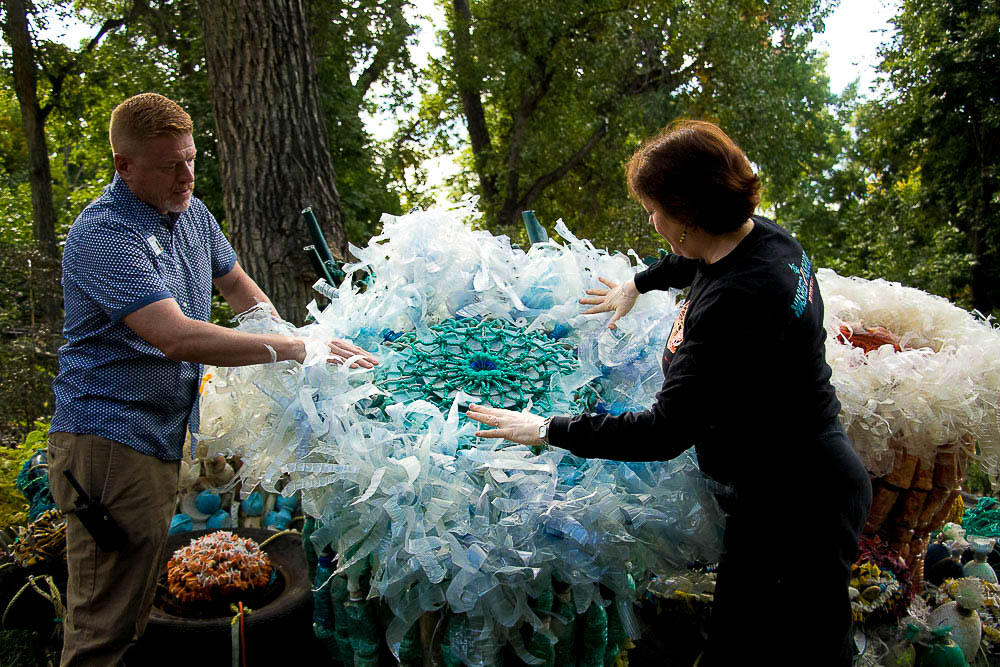 Ben Parks and Angela fluff the anemone garden at the Denver Zoo. (Chloe Aiello/Denverite)
