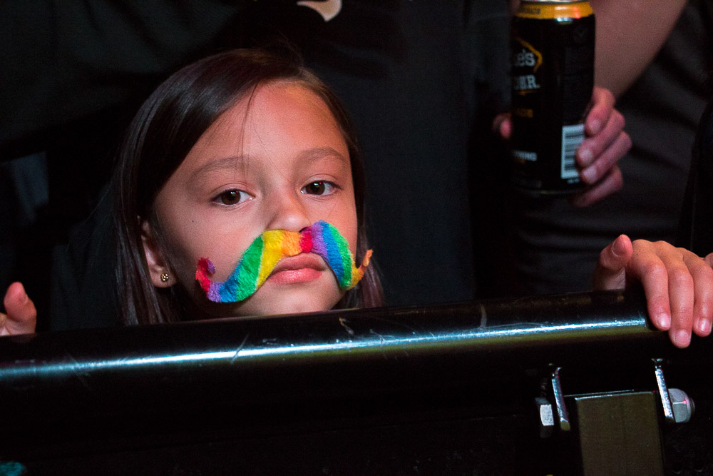 A little girl gets in the spirit at the Great American Beard and Moustache Championship. (Chloe Aiello/Denverite)