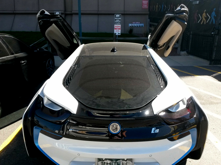 Kenneth Faried's BMW i8 with scissor doors. (Kevin J. Beaty/Denverite)  kenneth faried; sports; nuggets; kevinjbeaty; cars; denverite; colorado; denver;