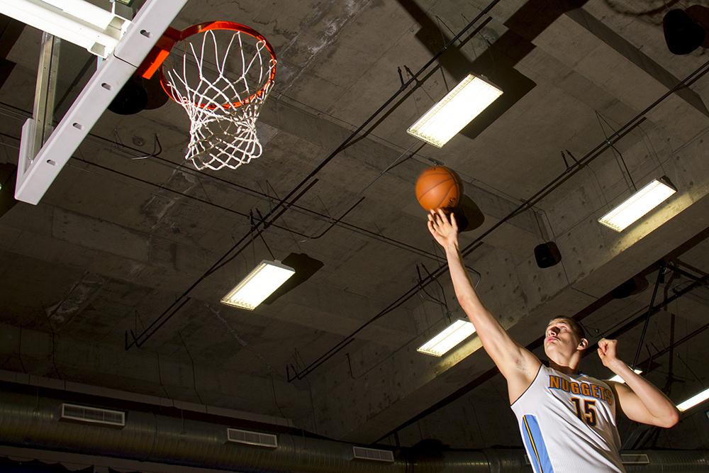 Center Nikola Jokić leaps to the basket during Denver Nuggets press day, Sept. 26, 2016. (Kevin J. Beaty/Denverite)  pepsi center; nuggets; basketball; sports; kevinjbeaty; denver; colorado; denverite;