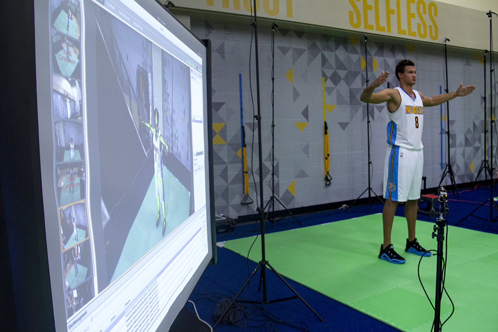 Danilo Gallinari has his body scanned by an array of cameras to analyze his movement at the Denver Nuggets press day, Sept. 26, 2016. (Kevin J. Beaty/Denverite)  pepsi center; nuggets; basketball; sports; kevinjbeaty; denver; colorado; denverite;