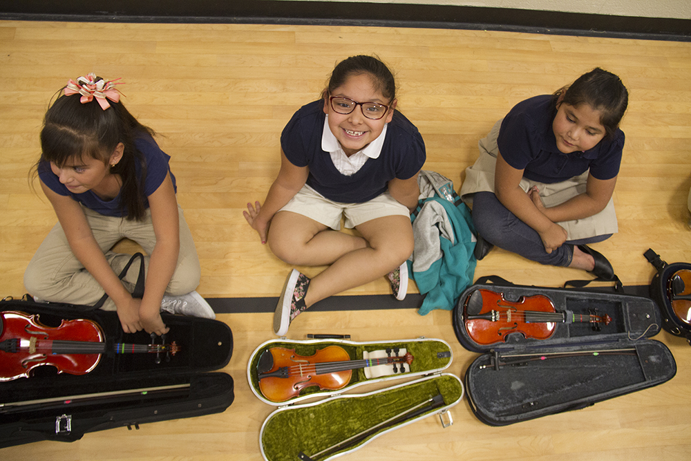Vevian (left to right), Andrea, and Gabriella wait to perform at Swansea Elementary. (Kevin J. Beaty/Denverite)