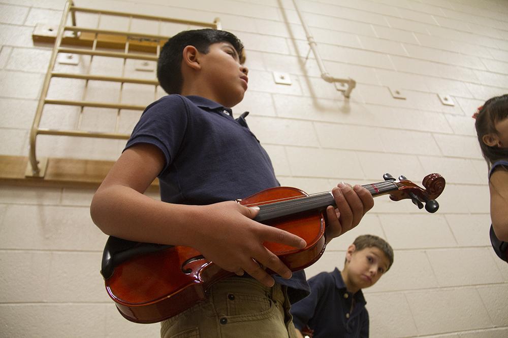 Kids wait to perform at Swansea Elementary. (Kevin J. Beaty/Denverite)  elyria swansea; swansea elementary; kids; school; hancock; development; gentrification; displacement; kevinjbeaty; denverite; denver; colorado;