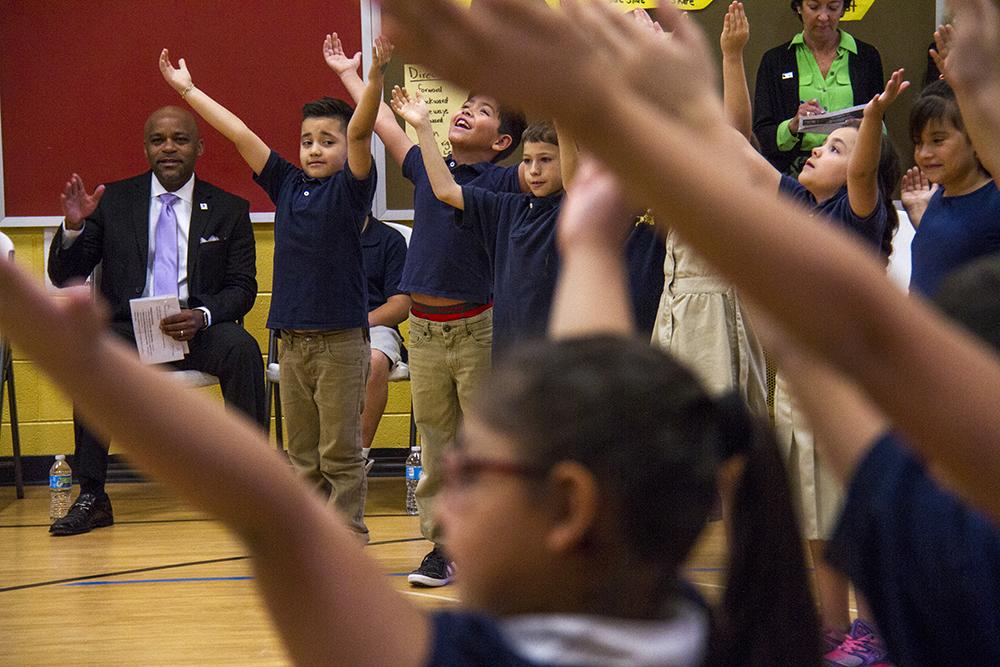 Mayor Michael Hancock watches students sing America the Beautiful. (Kevin J. Beaty/Denverite)  elyria swansea; swansea elementary; kids; school; hancock; development; gentrification; displacement; kevinjbeaty; denverite; denver; colorado;