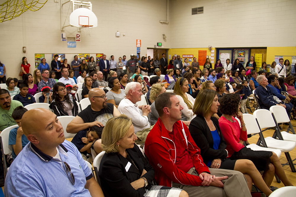 The crowd listens to the mayor speak at Swansea Elementary. (Kevin J. Beaty/Denverite)  elyria swansea; swansea elementary; kids; school; hancock; development; gentrification; displacement; kevinjbeaty; denverite; denver; colorado;