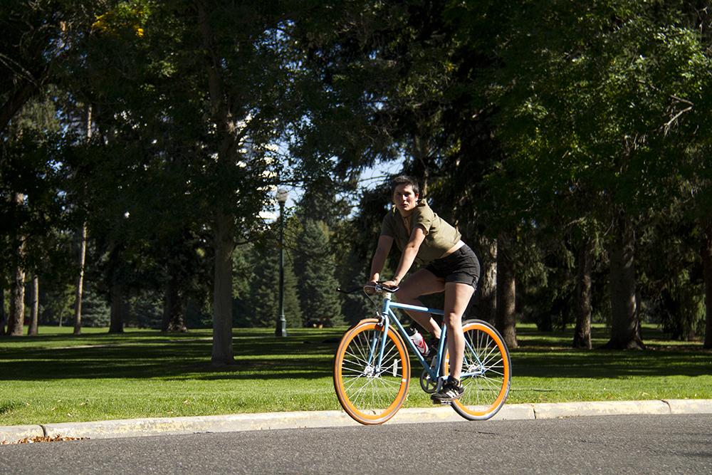 A biker in Cheesman Park. (Kevin J. Beaty/Denverite)